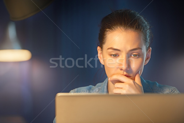 woman working on a laptop Stock photo © choreograph