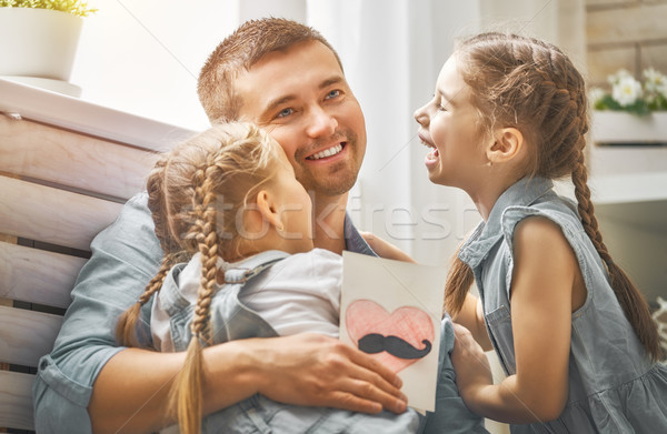 daughters congratulating dad Stock photo © choreograph