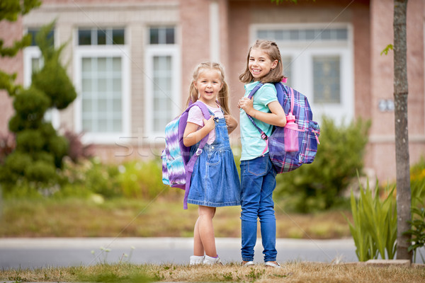 Girls with backpack is going to school Stock photo © choreograph