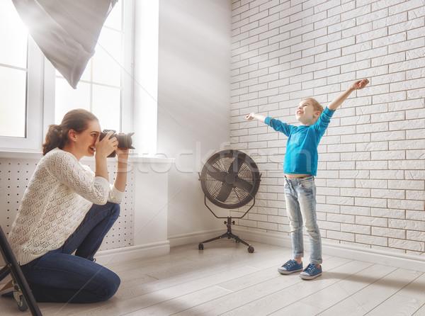 Photographe mouvement jeune femme photos enfant famille Photo stock © choreograph