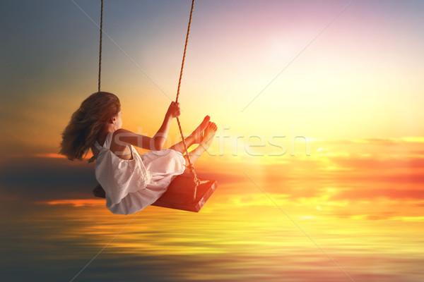 子 少女 スイング 幸せ 笑い 日没 ストックフォト © choreograph