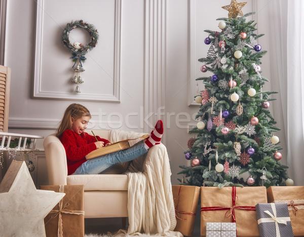 Dziewczyna list Święty mikołaj wesoły christmas szczęśliwy Zdjęcia stock © choreograph