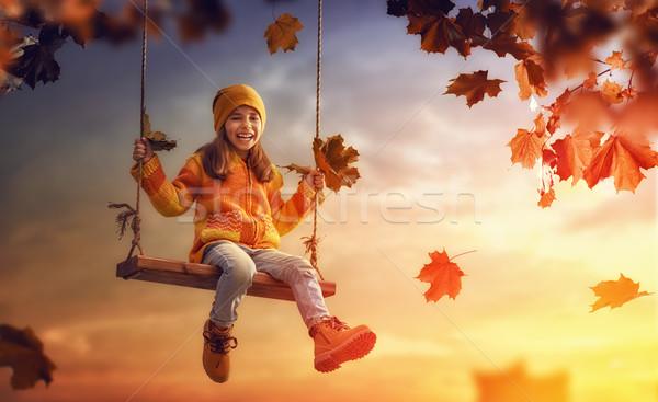 Ragazza swing felice bambino tramonto caduta Foto d'archivio © choreograph