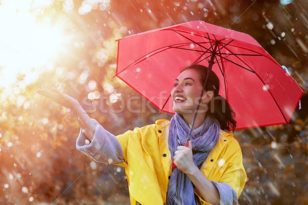 Donna rosso ombrello felice bella Foto d'archivio © choreograph