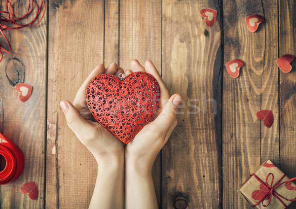 Valentin nap kezek nő tart piros szív Stock fotó © choreograph