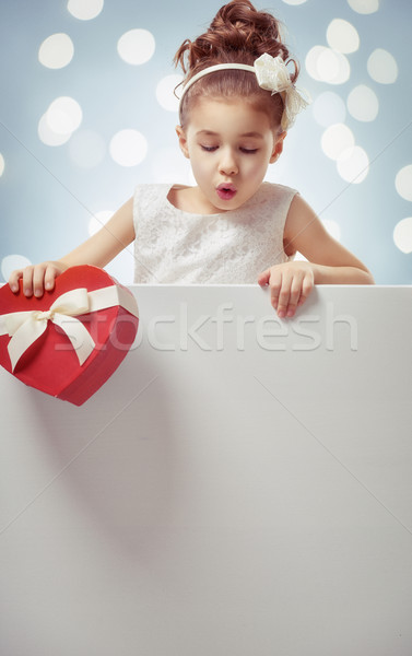 girl with white blank poster Stock photo © choreograph