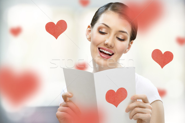 Amour lettre fille carte postale main sourire Photo stock © choreograph