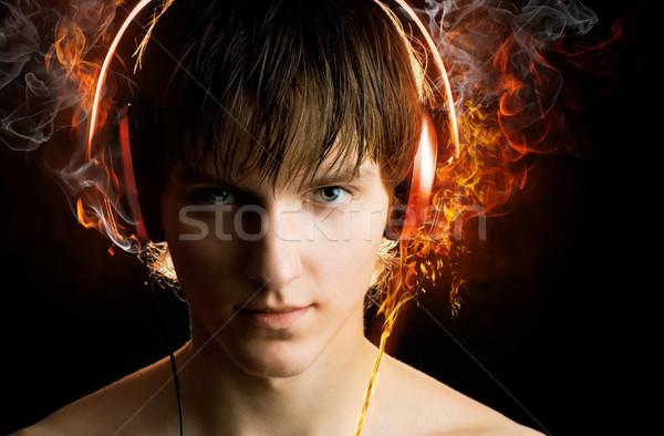 Uomo cuffie nero musica tecnologia arte Foto d'archivio © choreograph