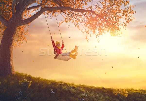 девушки Swing счастливым ребенка закат осень Сток-фото © choreograph