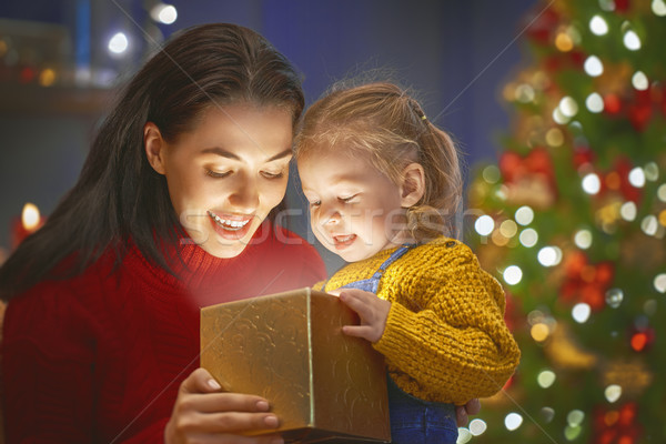 family with magic gift box Stock photo © choreograph