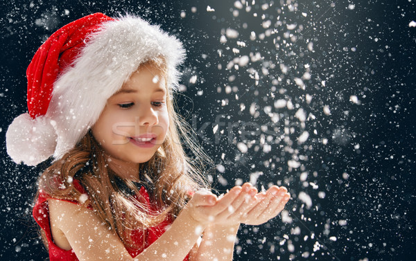 little girl catching snowflakes Stock photo © choreograph