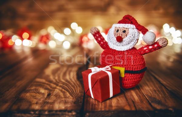 Rouge coffret cadeau Noël guirlande lumières Photo stock © choreograph