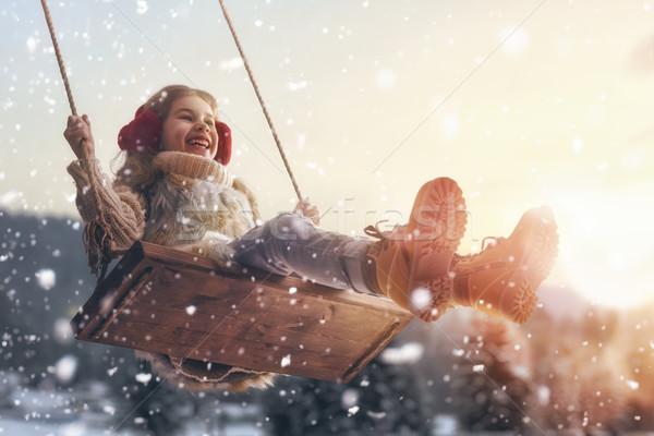 Kız salıncak gün batımı kış mutlu çocuk Stok fotoğraf © choreograph