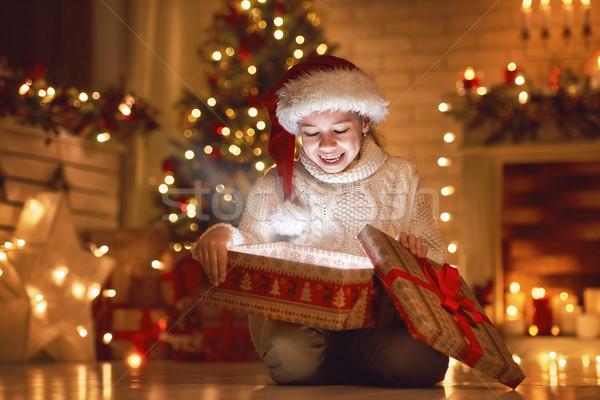 girl with gift near Christmas tree Stock photo © choreograph