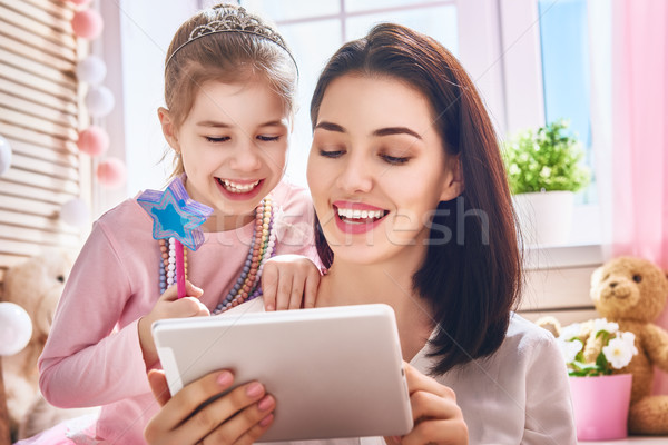 mom and child with tablet Stock photo © choreograph