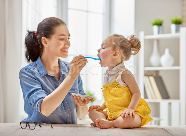 mother feeding her child Stock photo © choreograph