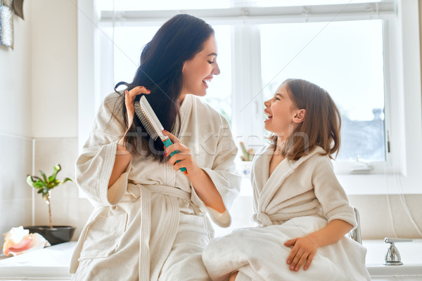 Mother and daughter combing hair Stock photo © choreograph