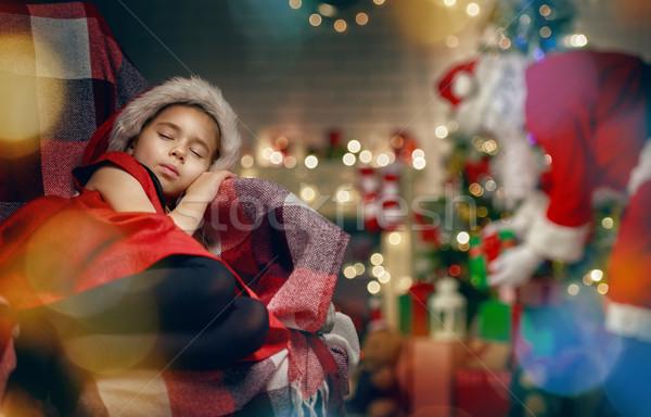 Babbo natale sorpresa piccolo dormire ragazza Foto d'archivio © choreograph