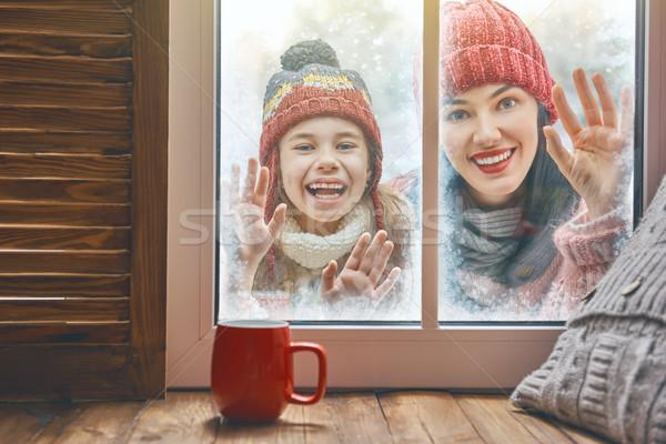 family on snowy winter walk Stock photo © choreograph
