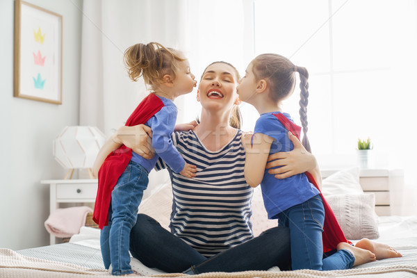 mother and daughters playing Stock photo © choreograph