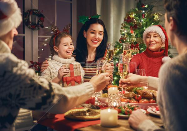 Család karácsony vidám boldog család vacsora otthon Stock fotó © choreograph