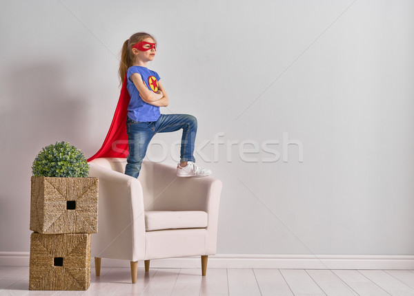 Stock photo: child is playing superhero