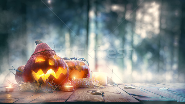 Pumpkins in spooky forest Stock photo © choreograph