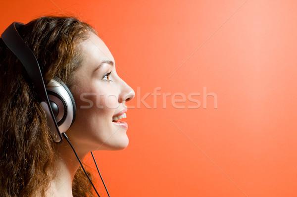 Сток-фото: девушки · наушники · оранжевый · вечеринка · моде · волос