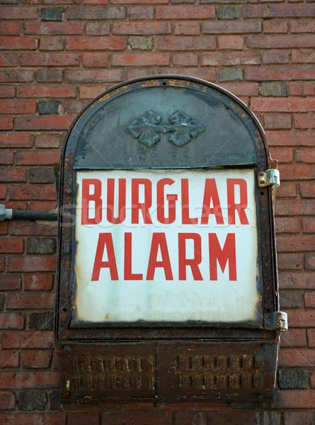 Einbrecher Alarm Jahrgang Backsteinmauer Wand Metall Stock foto © chrisbradshaw