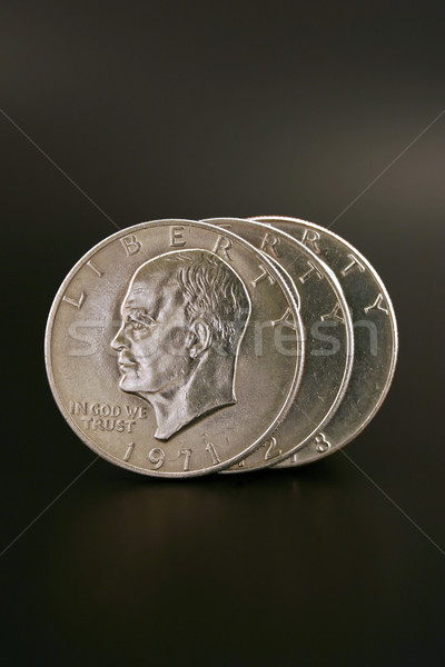 Három ezüst dollár izolált fekete pénz Stock fotó © chrisbradshaw