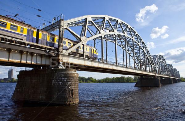 Tren haçlar demir köprü nehir Riga Stok fotoğraf © chrisdorney