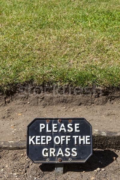 Af gras beleefd teken waarschuwing mensen Stockfoto © chrisdorney