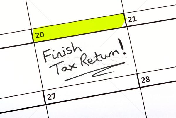 Belasting terugkeren datum geschreven kalender leven Stockfoto © chrisdorney