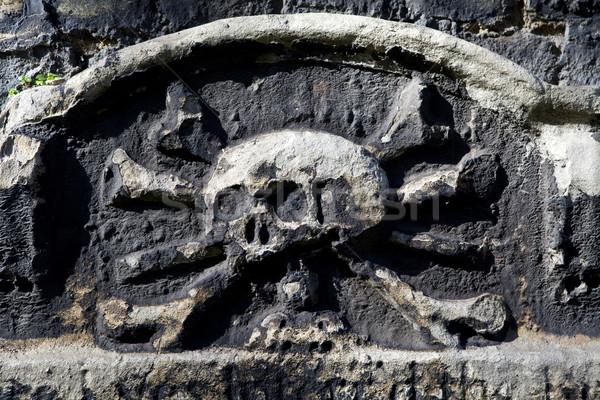 Skull & Crossbones Carving on a Gravestone Stock photo © chrisdorney