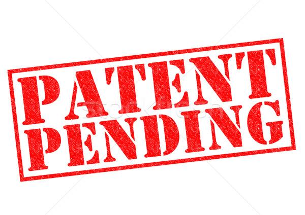 Patente pendiente rojo blanco sexo Foto stock © chrisdorney