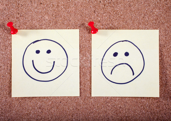 Happy and Sad Faces Pinned to a Noticeboard Stock photo © chrisdorney