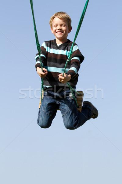 Happy child on a swing Stock photo © chrisroll