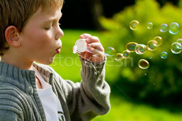 Buborékfújás kicsi gyermek arc szemek haj Stock fotó © chrisroll