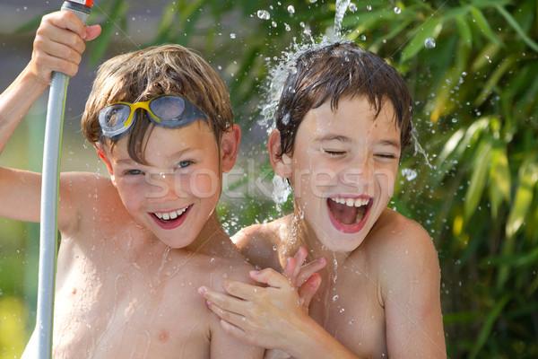 Enfants jouer eau jeunes famille visage Photo stock © chrisroll