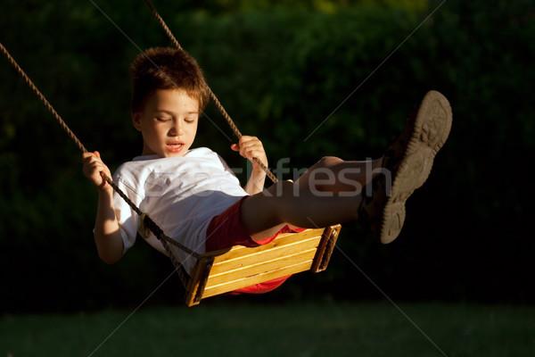 çocuk salıncak genç oynama çocuklar turuncu Stok fotoğraf © chrisroll