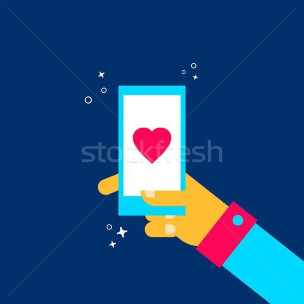 Człowiek online dating telefonu komórkowego app Zdjęcia stock © cienpies