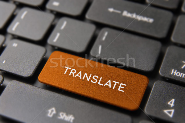 Traduction Ouvrir la clavier d'ordinateur portable langue rouge ordinateur Photo stock © cienpies