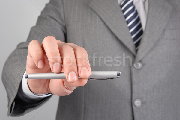Businessman giving you the pen Stock photo © cienpies