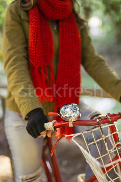 Close up of retro bike with trendy fashion girl Stock photo © cienpies