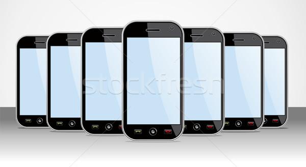 Set of generic Smartphones device useful for app templates Stock photo © cienpies
