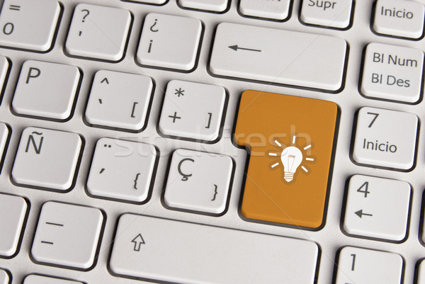 Internet business new ideas concept, light bulb keyboard key. Stock photo © cienpies