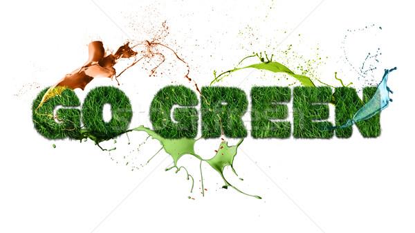 Go Green sign and splash Stock photo © cienpies