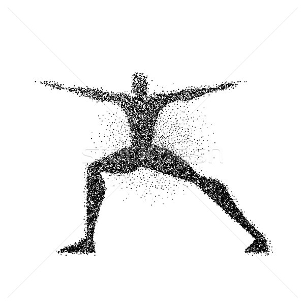 Man doing yoga pose in particle dust splash  Stock photo © cienpies
