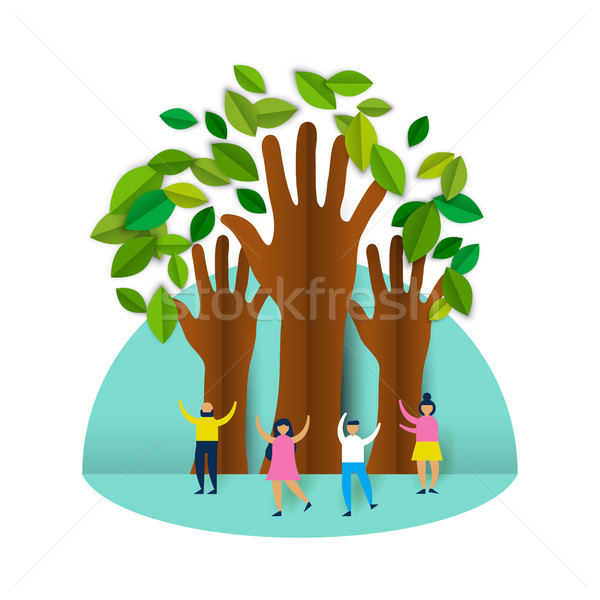 Happy eco friendly people group with paper trees Stock photo © cienpies