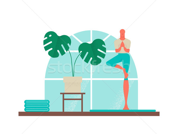 Boy doing yoga tree pose for healthy lifestyle  Stock photo © cienpies
